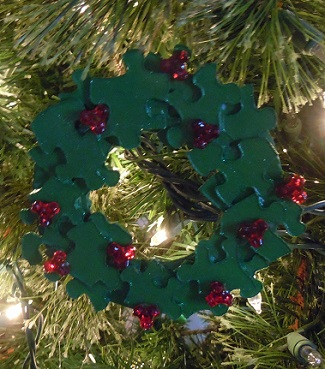 wreath christmas ornament made from puzzle pieces