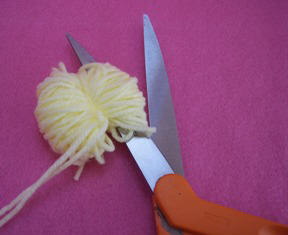 cut the loops to make a pom pom