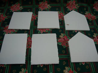 Cut foam core board to make a gingerbread house