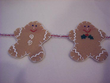 paint swirls or holly on your  gingerbread men