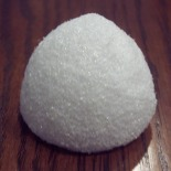 Squeeze the top of a Styrofoam ball into a gumdrop shape and paint with acrylic paint.