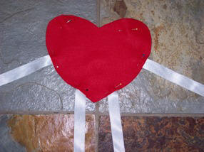 Step by step instructions for sewing a felt heart person for Valentine's Day