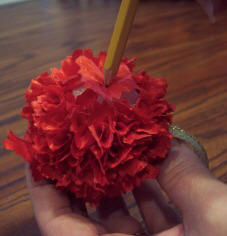 Use a pencil to poke scrap fabric into a Styrofoam ball to make an easy kids Christmas craft.