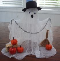 craft a ghost from cheesecloth and dress him in a top hat.