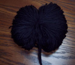 how to make a pompom tie yarn around the loops