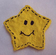 paper mache star Christmas ornament