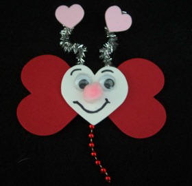 Make a butterfly from craft foam hearts with free instructions from Craft Elf