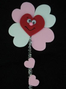 flower magnet made from craft foam hearts and pipeceaners